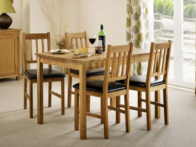 Product photograph showing Coxmoor Oak Rectangular Dining Table 4 Dining Chairs