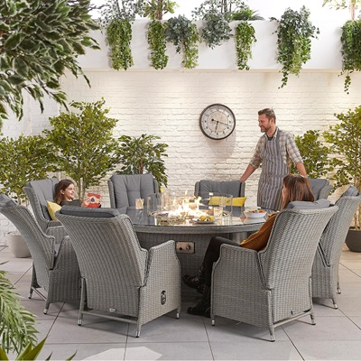Product photograph showing Heritage Carolina 8 Seat Dining Set With Fire Pit - 1 8m Round Table